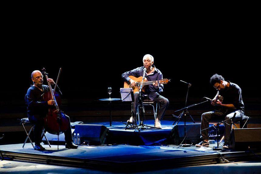 Brazilian Bossa Nova legend Gilberto Gil (centre) performing at the Esplanade Concert Hall in 2011 with cellist Jaques Morelenbaum (left) and son Bem.