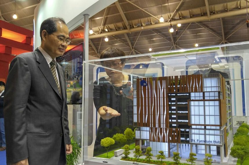 Trade and Industry Minister Lim Hng Kiang looking at the model of the JTC Furniture Hub@ Sungei Kadut.