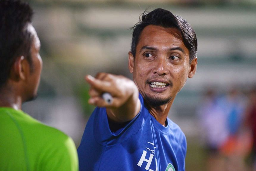 Geylang International's coach Hasrin Jailani giving instructions to his team during a friendly match.