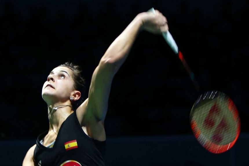 Carolina Marin returns a shot to Nozomi Okuhara during their women's single semi-final match in the Dubai World Superseries Finals on Dec 12, 2015.