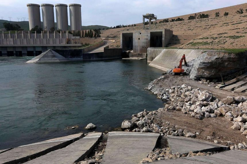 The US is warning of a humanitarian catastrophe if the Mosul dam (pictured) collapses.