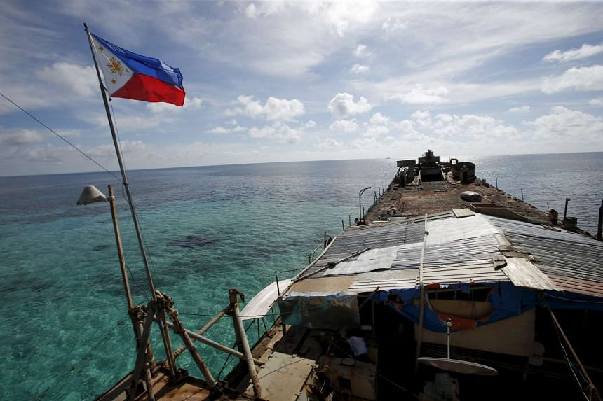A Philippine flag flutters from a Philippine Navy ship, which became a military detachment on the disputed Second Thomas Shoal, part of the Spratly Islands, in the South China Sea, on March 29, 2014.