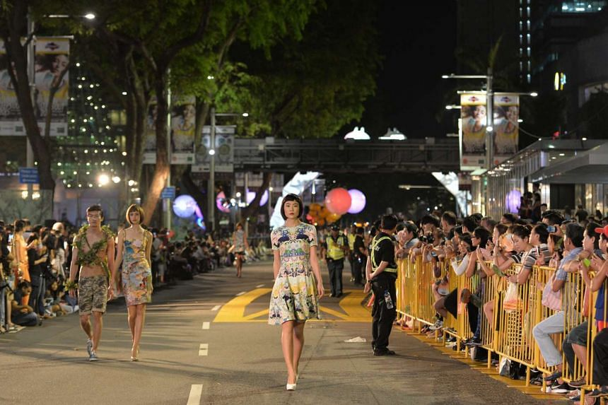Models strutting down a 550m-long outdoor runway for Samsung Fashion Steps Out 2015 at Orchard Road.
