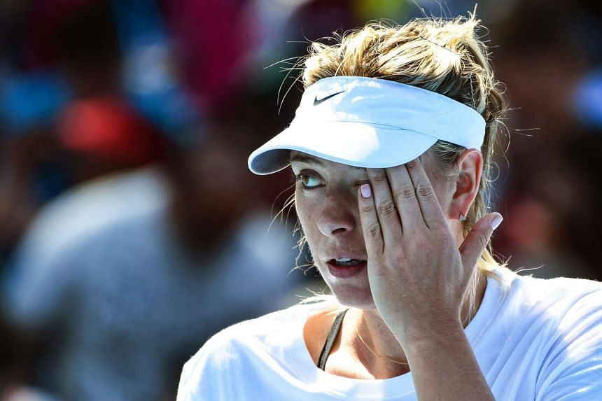 Maria Sharapova of Russia reacts during a training session prior the Australian Open in Melbourne, on Jan 16, 2016.