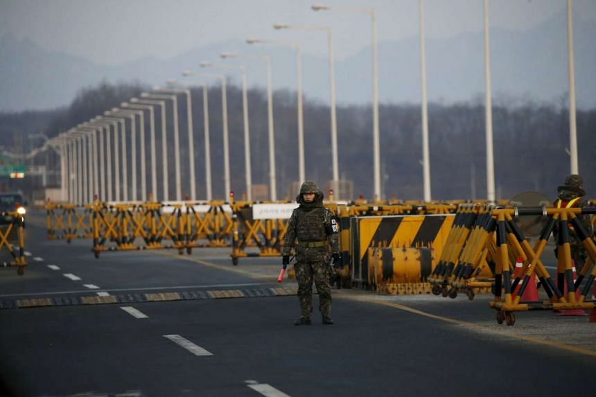 A South Korean soldier stands at a checkpoint on the Grand Unification Bridge leading to the inter-Korean Kaesong Industrial Complex in North Korea, in Paju, South Korea, on Feb 11, 2016.