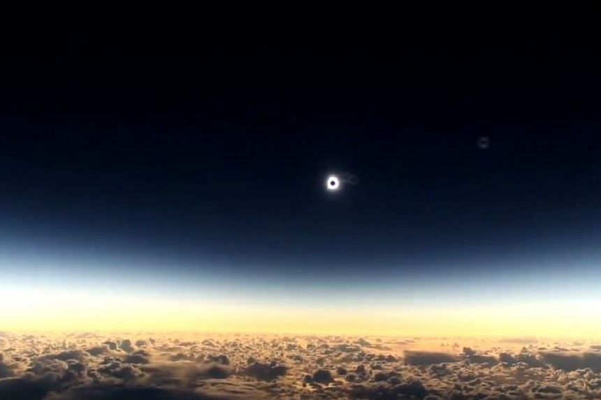 The total solar eclipse on Wednesday (March 9) as seen from an Alaska Airlines flight 11,000m in the air.