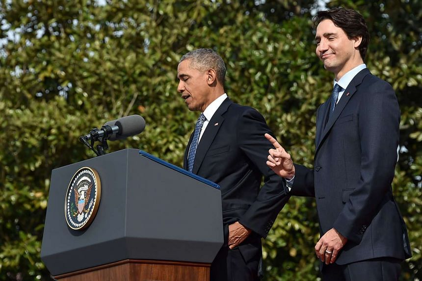 US President Barack Obama and Canada's Prime Minister Justin Trudeau take part in a welcome ceremony during a State Visit on the South Lawn of the White House on March 10, 2016 in Washington, DC.