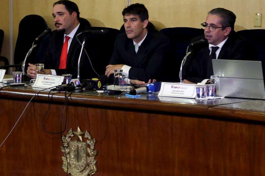 Sao Paulo state prosecutors Jose Carlos Blat, Cassio Roberto Conserino and Fernando Henrique de Moraes Araujo attend a news conference at the attorney general's office in Sao Paulo, Brazil, on March 10, 2016.