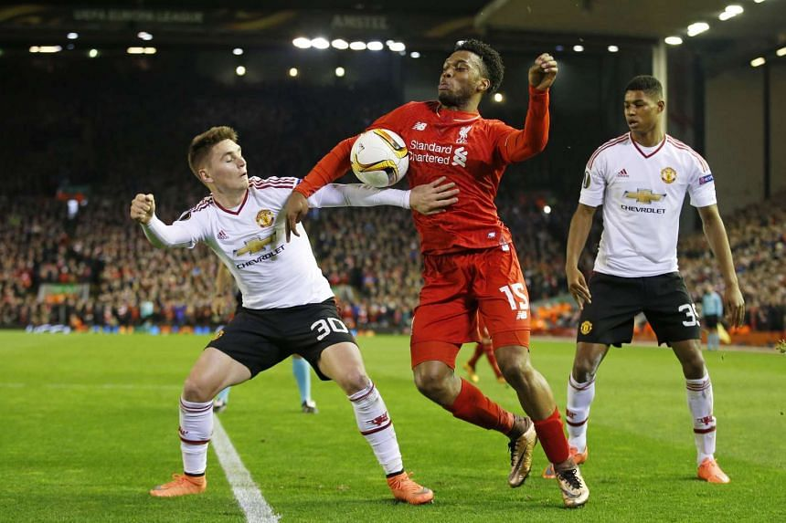 Manchester United's Gullermo Varela in action with Liverpool's Daniel Sturridge at UEFA Europa League Round of 16 First Leg on March 10, 2016.