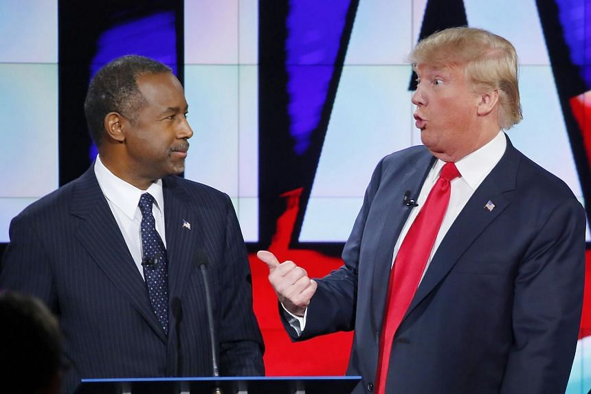 US presidential candidate Donald Trump talks with Dr Ben Carson during the Republican presidential debate in Las Vegas, Nevada on Dec 15, 2015.
