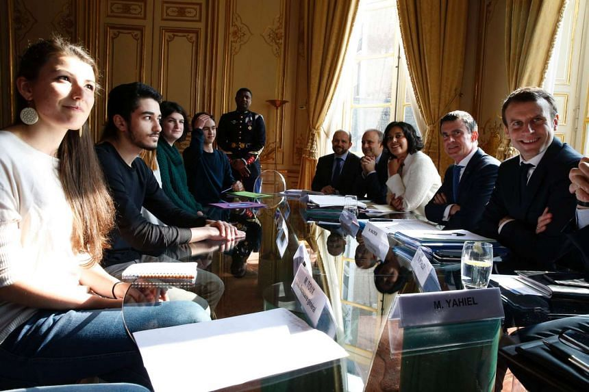 Representatives of French high school student unions at a meeting with French Prime Minister Manuel Valls (second from right), French Labour Minister Myriam El Khomri (third from right) and French Economy Minister Emmanuel Macron (right) at the Hotel