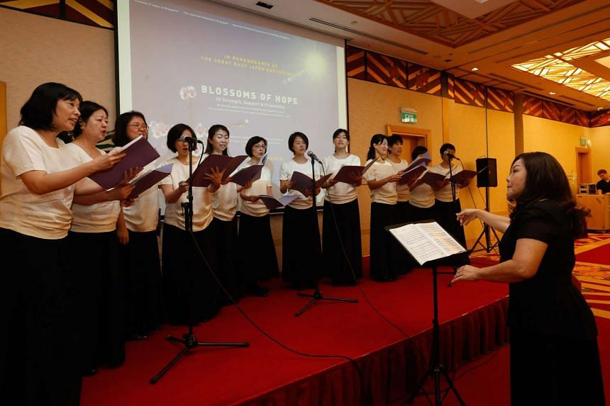 "The Ladies Chorus of the Japanese Association of Singapore performed two songs at the ""Five Years after the Great East Japan Earthquake"" reception yesterday."