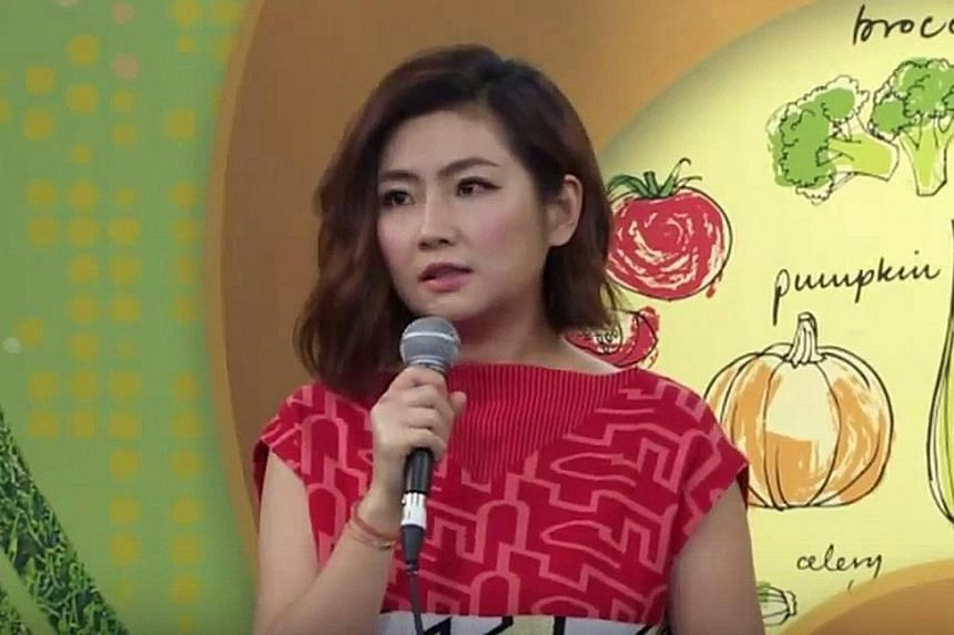 S.H.E singer Selina Jen speaking to the press at a taping of the television show Stay Healthy Stay Happy.