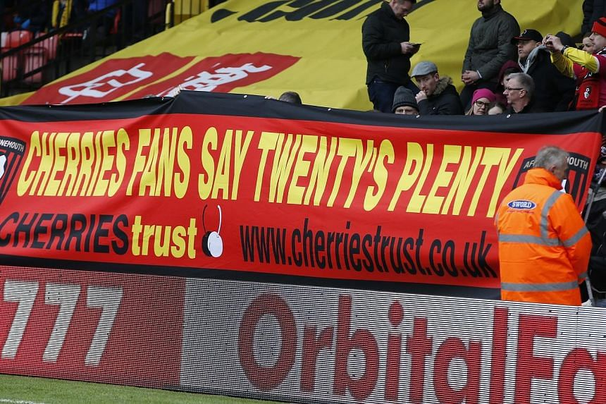 Bournemouth fans displaying a poster at Watford revealing their thoughts about away ticket prices. While they did not get the figure they lobbied for, fan representatives have expressed approval at the £30 price caps.