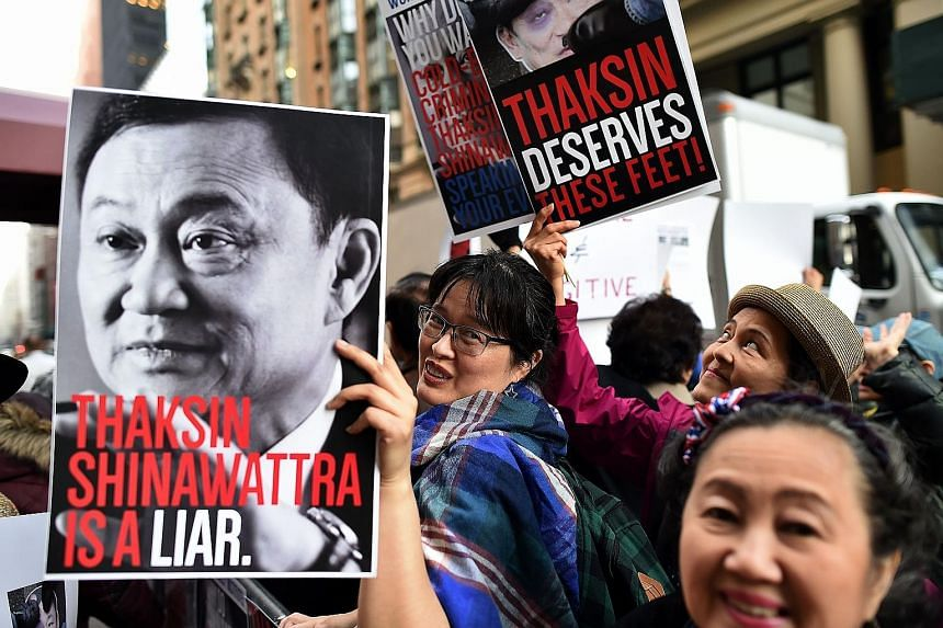 Demonstrators protesting against Thaksin on Wednesday outside a New York private club, where the deposed Thai premier was speaking at an event.
