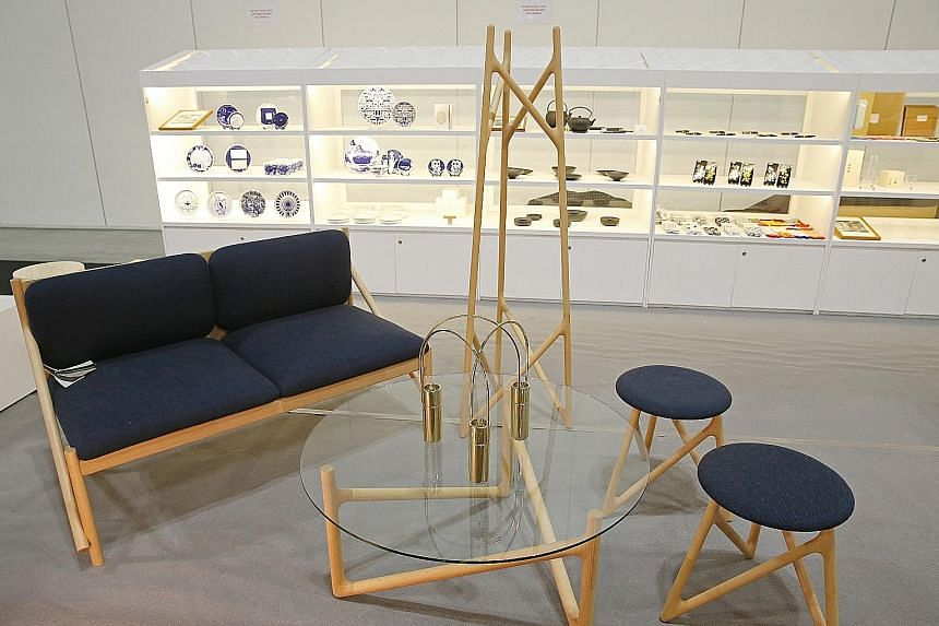 Supermama collaborates with Japanese furniture-maker Legnatec to create wooden furniture (left).