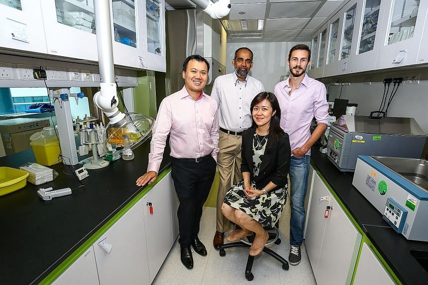 (From left) Wangi Industrial's Mr Chew, A*Star's Dr M.S.M. Saifullah, Dr Chong and Dr Mark Moxey. Wangi is working with A*Star to develop a water- and grease-repellent screen.