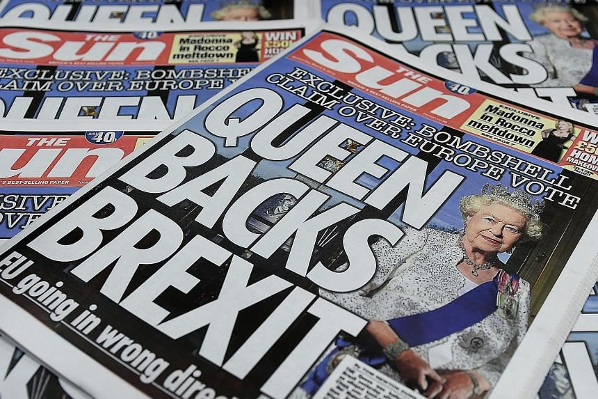 """Copies of Britain's The Sun newspapers with a front-page story saying Queen Elizabeth II backed Brexit. A spokesman for the royal family has stated that the Queen is """"politically neutral""""."""