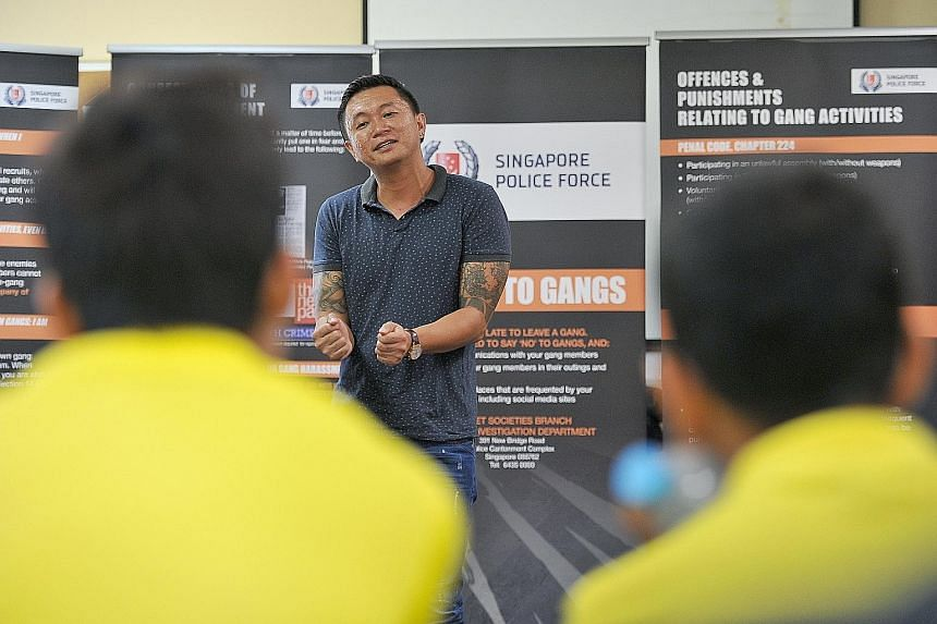 Mr Kim (left), who was in a gang for 10 years and is now a pottery artist, sharing his experiences with teens at Camp Ace, aimed at youngsters associated with gangs.