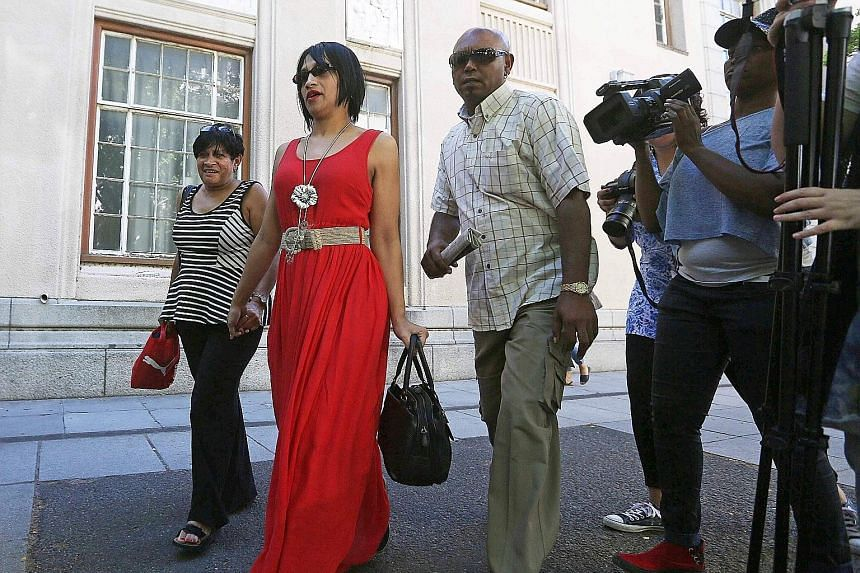 Ms Celeste Nurse (second from left), the biological mother of a South African girl who was abducted after birth, leaving the Cape Town magistrates' court with family members on Feb 27 last year.