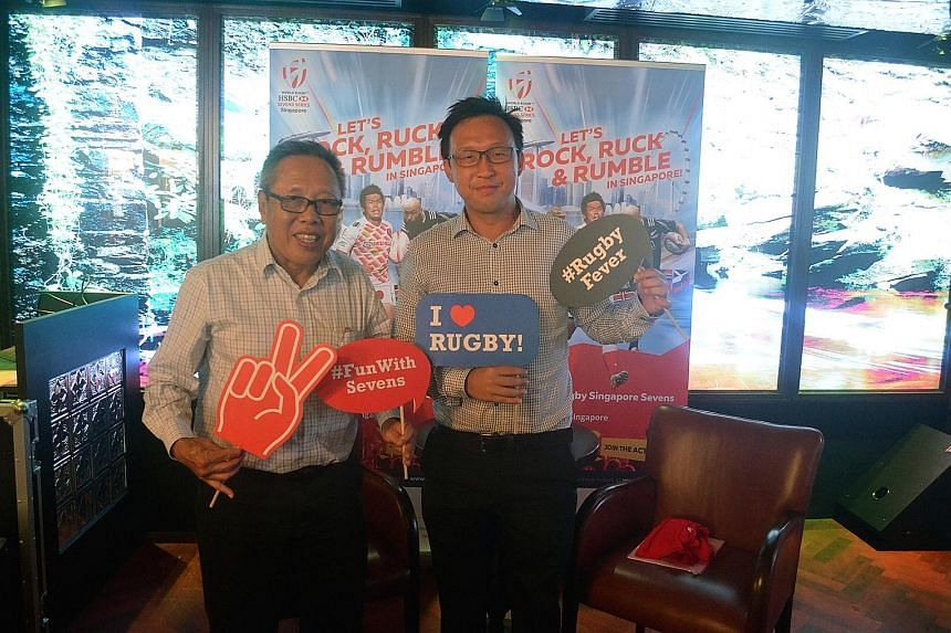 Rugby SG chairman Low Teo Ping (left) posing with Clarke Quay's Adrian Lai, ahead of the Singapore Sevens on April 16-17.