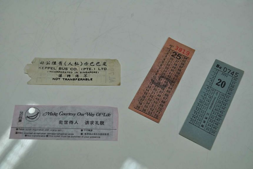 In the early to mid-20th century, a bus conductor would dispense a bus ticket after punching a hole in it.