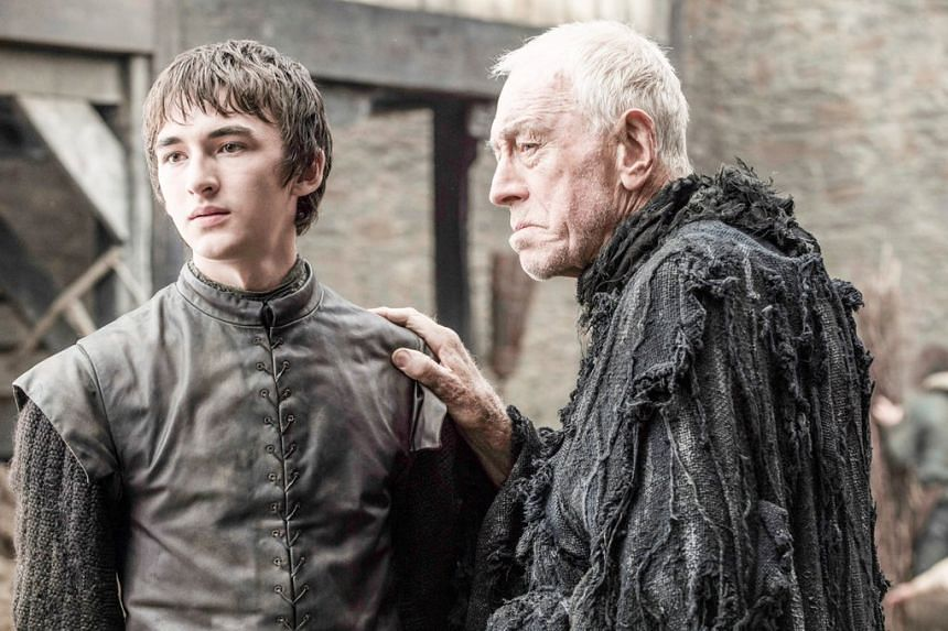 Actors Isaac Hempstead Wright (left) as Bran Stark and Max von Sydow as the Three-Eyed Raven in Game of Thrones Season 6.