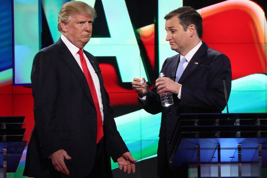 Republican presidential candidate Donald Trump (left) with rival Ted Cruz during a break at the Republican US presidential candidates debate in Miami, on March 10, 2016.