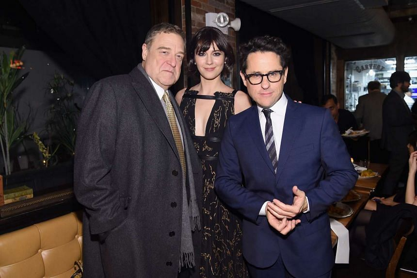 Actor John Goodman, actress Mary Elizabeth Winstead, and producer J.J. Abrams attend the 10 Cloverfield Lane New York premiere after party.