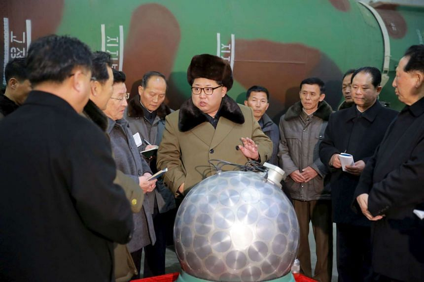 North Korean leader Kim Jong Un meets researchers for nuclear weapons in this undated photo released by North Korea's Korean Central News Agency (KCNA) on March 9, 2016.
