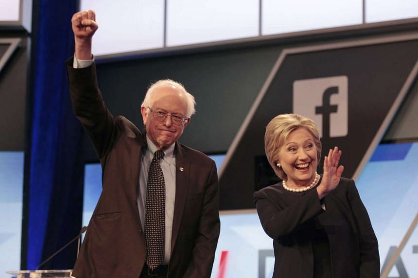 Democratic candidates Bernie Sanders and Hillary Clinton before the start of a debate in Kendall, Florida, on March 9.