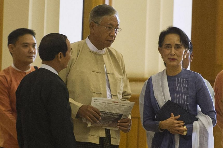 Myanmar lower house parliament speaker Win Myint (second, left), Mr Htin Kyaw (second, right) and Myanmar pro democracy leader Aung San Suu Kyi (right) arriving at the lower house of parliament in Naypyidaw on March 11, 2016.
