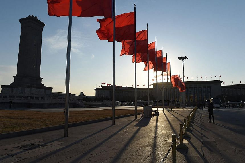 Flags flying in Tiananmenm Square after the second plenary session of the National People's Congress in Beijing on March 9.