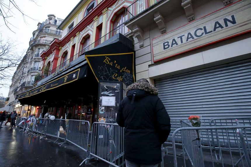 A security guard stands in front of the Bataclan concert hall on Feb 24, 2016.