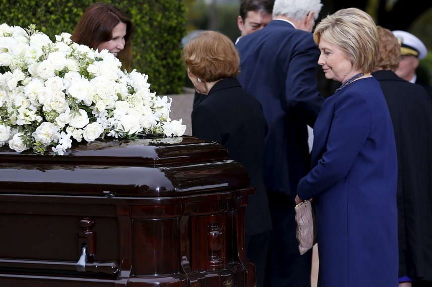 Former first lady Rosalynn Carter (centre) and former first lady Hillary Clinton (right) paying their respects during the funeral for former first lady Nancy Reagan at the Ronald Reagan Presidential Library in Simi Valley, California March 11, 2016.