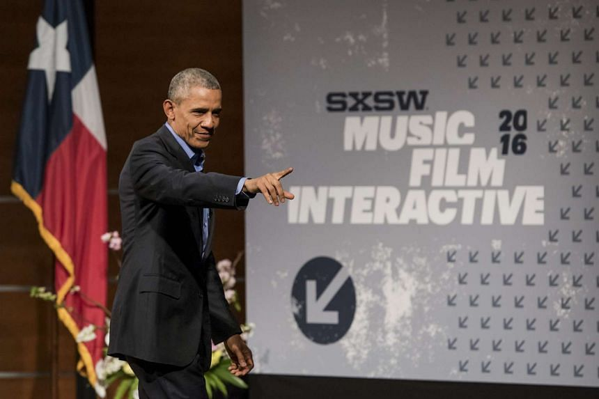US President Barack Obama gestures to audience members after speaking at the South By Southwest (SXSW) Interactive Festival in Austin, Texas, US, on Friday, March 11, 2016. The SXSW Interactive Festival features presentations and panels from the brig