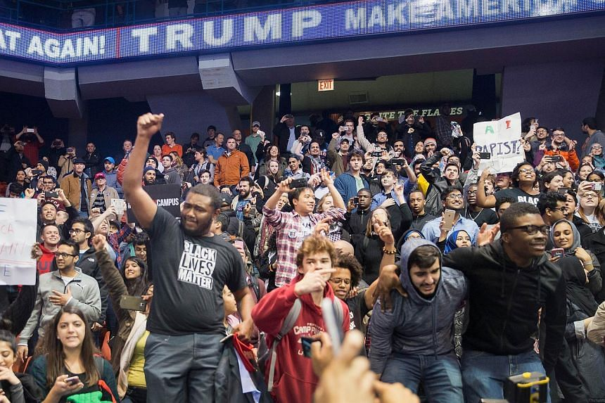 Demonstrators celebrating after it was announced that a rally with US Republican presidential candidate Donald Trump at the University of Illinois at Chicago would be postponed on March 11, 2016.