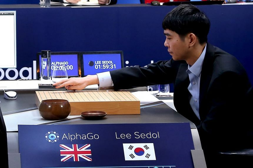 Lee Sedol puts the first stone against AlphaGo during the third match of Google DeepMind Challenge on March 12, 2016.