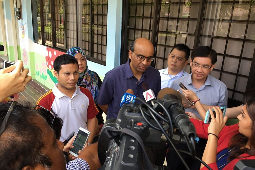 Deputy Prime Minister Tharman Shanmugaratnam speaking to reporters on Saturday.
