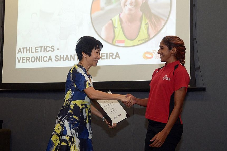 Minister for Culture, Community and Youth Grace Fu handing Shanti Pereira her award. The SEA Games 200m champion is thankful for the backing she will get as she bids to race at the 2018 Asiad and 2020 Olympics.