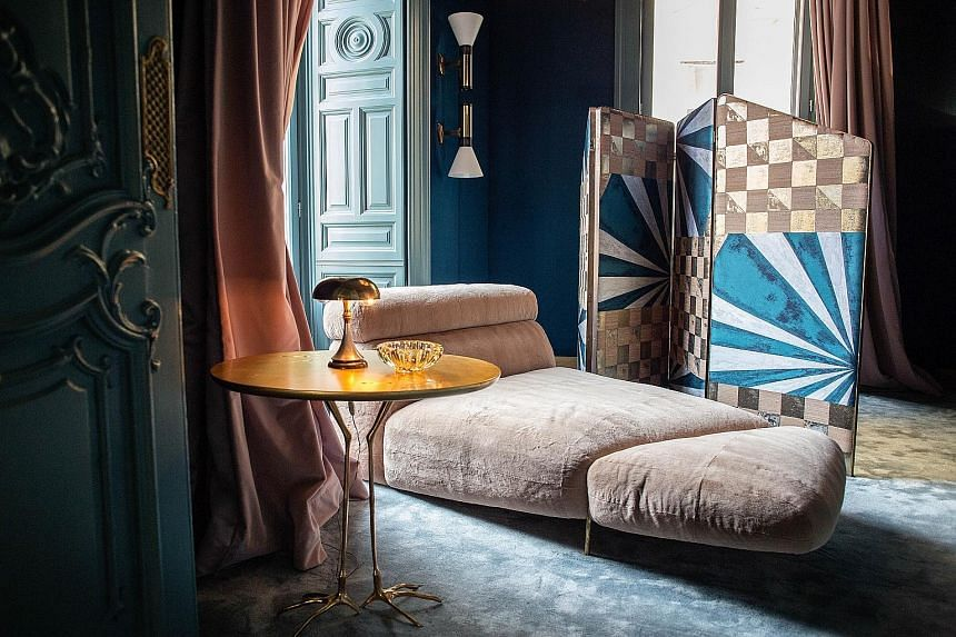 For a cosy spot at the Palazzo Prive, head for this chaise longue. (Above) The lobby of a Fendi Private Suite. (Left) There are seven Fendi Private Suites. Amenities include Fendi Casa bed and bath linen. (Top) The Palazzo Prive has a gathering spot