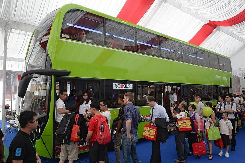 One of two concept double- decker buses, featuring three doors and two stairways, on display at the Bus Carnival at Ngee Ann City yesterday. Visitors can give feedback on the features and configuration of the buses. The carnival ends tomorrow but wil