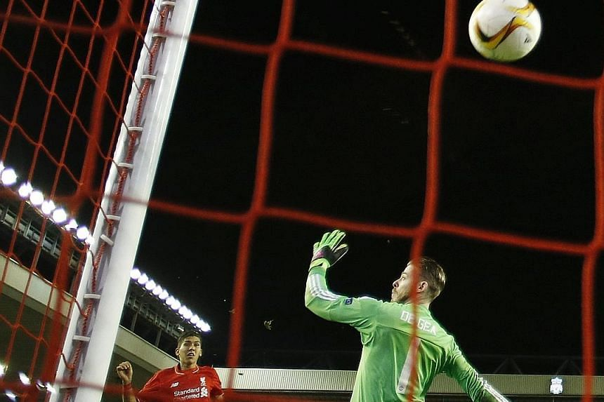 Roberto Firmino sealed Liverpool's victory with a rising shot past Manchester United custodian David de Gea in the first leg of their Europa League last-16 tie. United were abject in their defeat by the Reds, the first time England's two most success