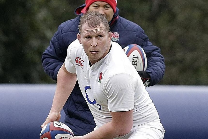 England coach Eddie Jones watching captain Dylan Hartley during training. The hooker and other senior players want a 'substantial' trophy before they retire.