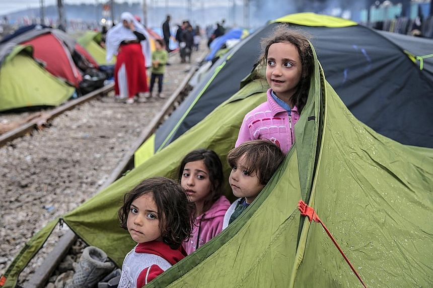 Refugees at the border between Greece and Macedonia. After Slovenia, Croatia, Serbia and Macedonia sealed their borders to the migration flow, tens of thousands of people have been left stranded in Greece.