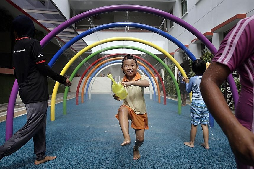 James Lim Yu Hong, a six-year-old pupil attending the AWWA Early Intervention Centre, has a whale of a time playing in the wet area of a new sensory playground installed in AWWA School. The playground, which has wet and dry areas, will help children