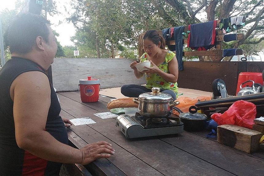 Mr Ong and his wife eat and sleep on the back of his lorry. They cook on a portable stove and sleep on cardboard. The deliveryman, who has been living on his lorry with his pregnant wife, hopes to be able to rent a room by the time their baby is born