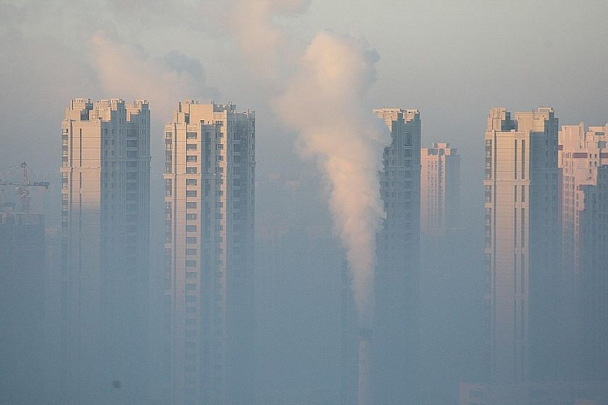 Harbin, in Heilongjiang Province, shrouded in pollution on Jan 21. Environment Minister Chen says air quality has improved despite three severe bouts of pollution late last year.