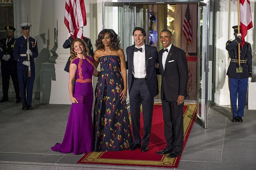 US President Obama (right) and his wife Michelle (second from left) with Canadian Prime Minister Trudeau and his wife Sophie before the White House state dinner, the first for a Canadian prime minister in nearly two decades.