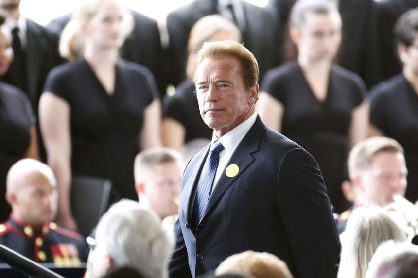 Former California Governor Arnold Schwarzenegger arrives for the funeral of Nancy Reagan.